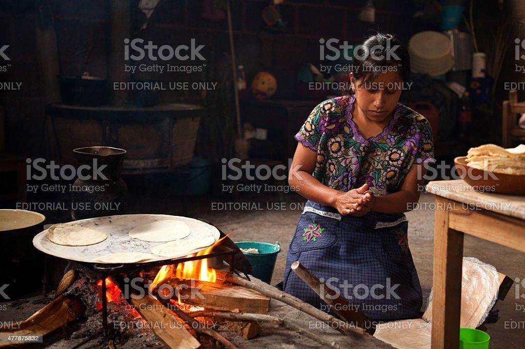 Tzotzil woman makes corn tortillas in Zinacantan/Mexico stock photo