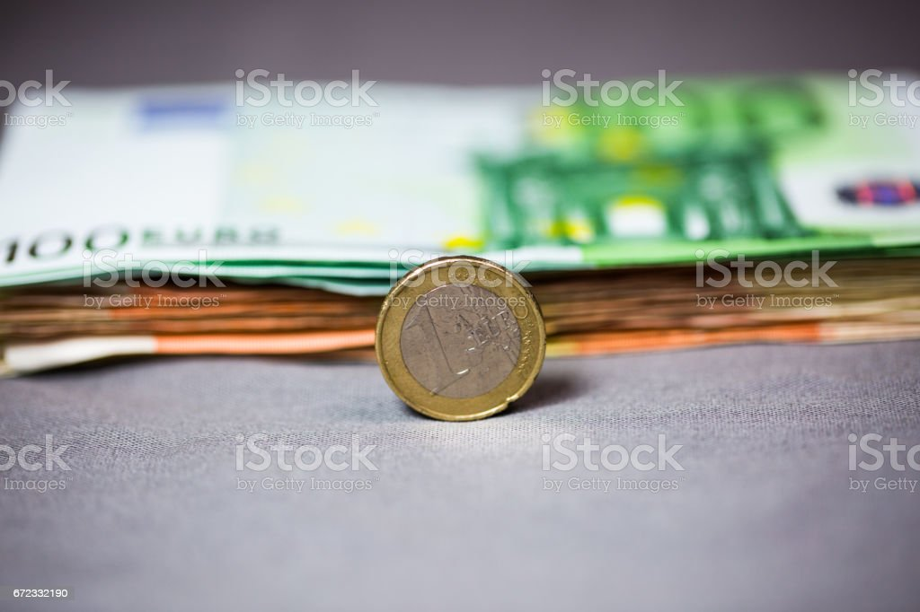 1 'u20ac Coin before banknotes, free space stock photo