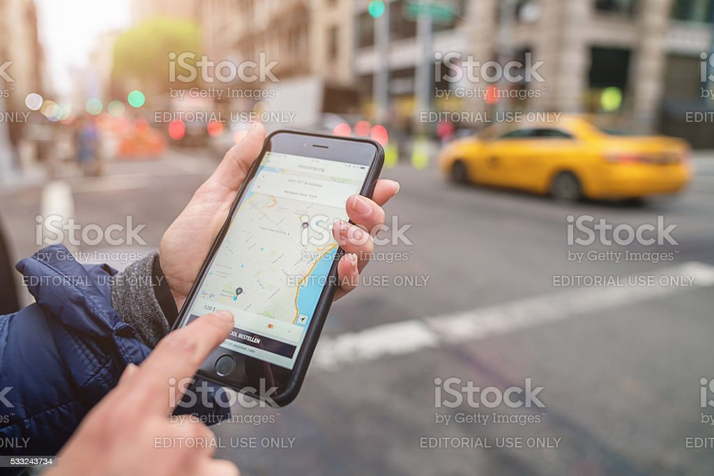 Uber Cab Apple iPhone 6s New York City Taxi Call stock photo