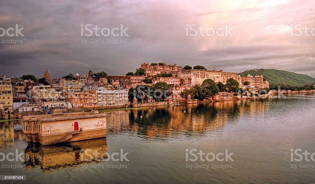 Udaipur City Palace alongside Lake Pichola stock photo