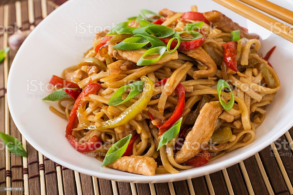 Udon noodles with chicken and peppers - Japanese cuisine stock photo