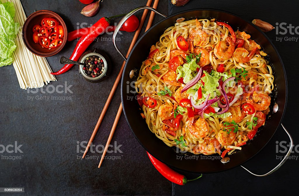 Udon pasta with shrimp, tomatoes and paprika. Top view stock photo