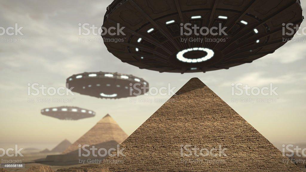 UFOs above Egypt pyramids stock photo