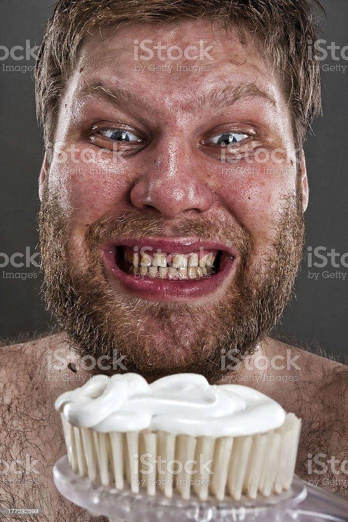 Ugly brushing teeth royalty-free stock photo
