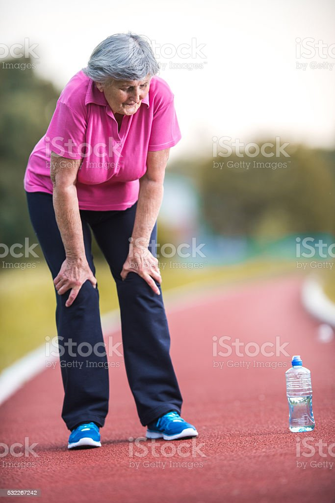 Uh, I am feeling so tired after running! stock photo