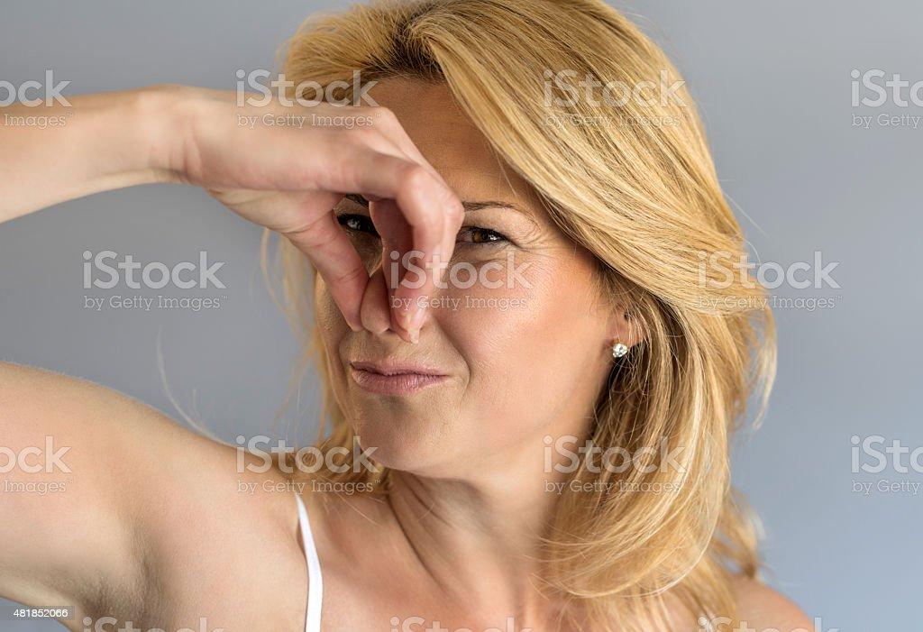 Uh, something smells very bad! stock photo