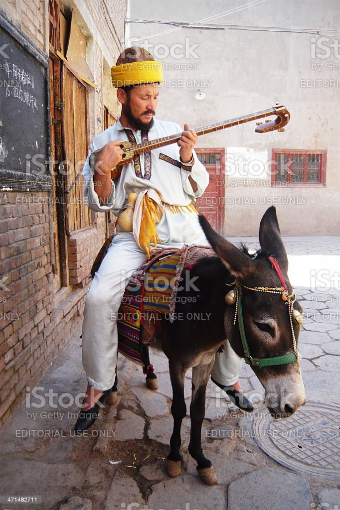 Uighur Man on a Donkey stock photo