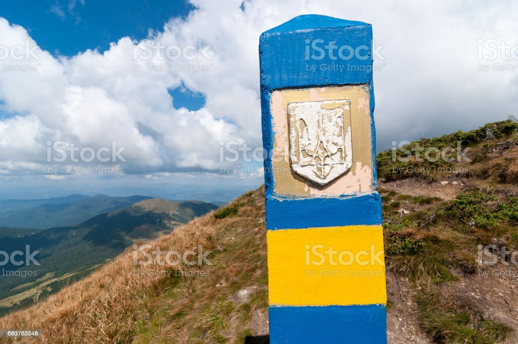Ukraine border. Frontier in Carpatian mountains, as a symbol of visa-free regime with Europe. Open Ukraine and Europian Union travel concept stock photo