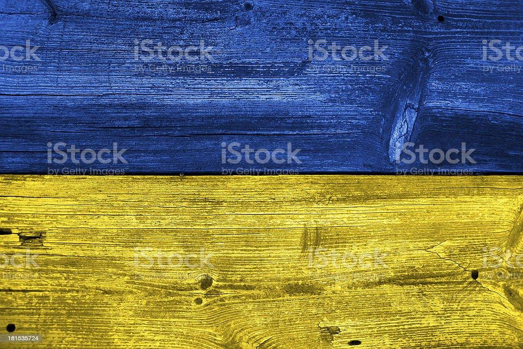 Ukraine Flag painted on old wood plank background royalty-free stock photo