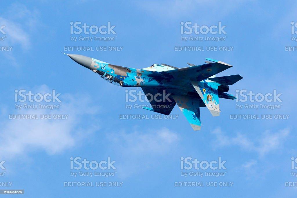 Ukrainian 2-seat Flanker peforming over the sea stock photo