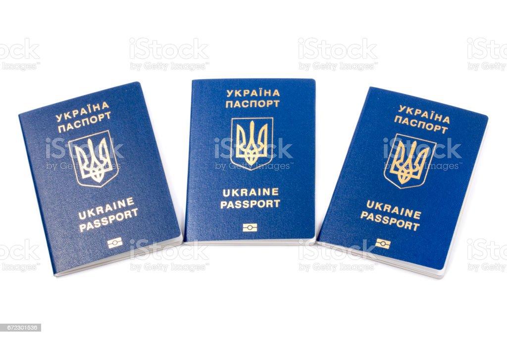 Ukrainian biometric passports on a white background stock photo