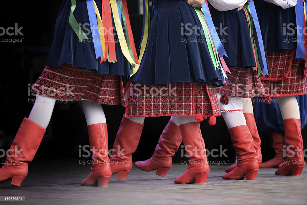 Ukrainian Dancers in traditional costumes and red boots on stage stock photo