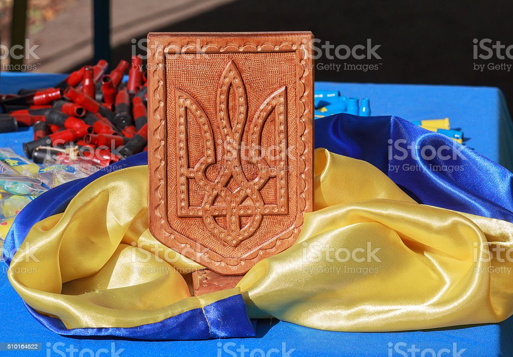 Ukrainian flag, coat of arms and machine-gun shells stock photo