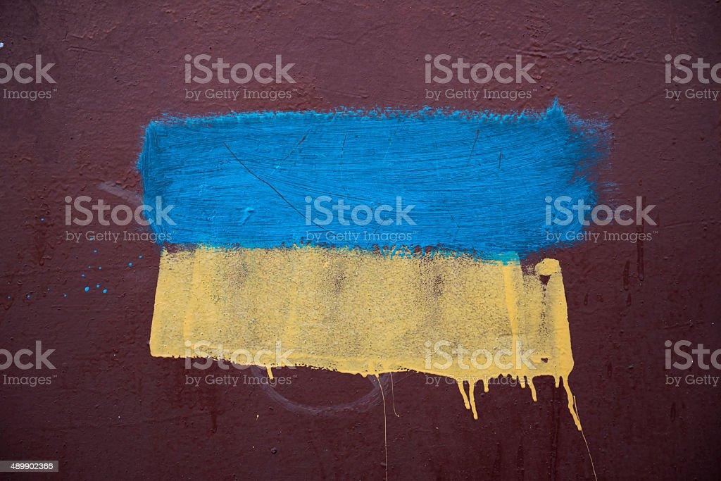Ukrainian flag pained on metal wall stock photo