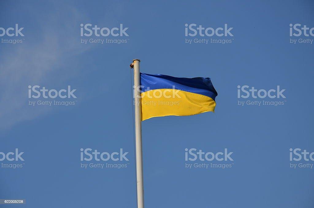 ukrainian flag with a blue sky stock photo