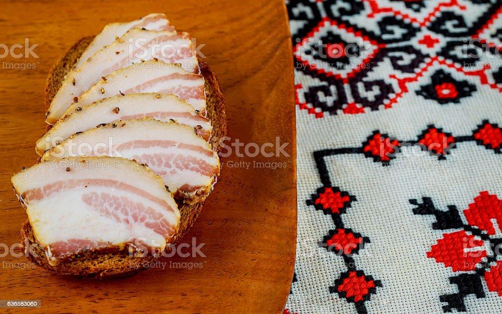 Ukrainian food Appetizing slices of salo lie  table stock photo