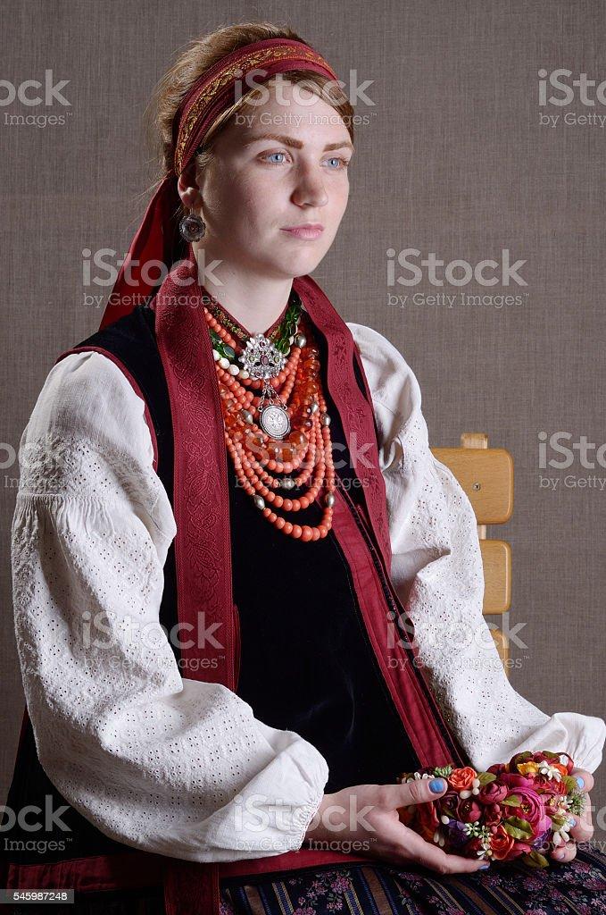Ukrainian girl in the folk costume stock photo
