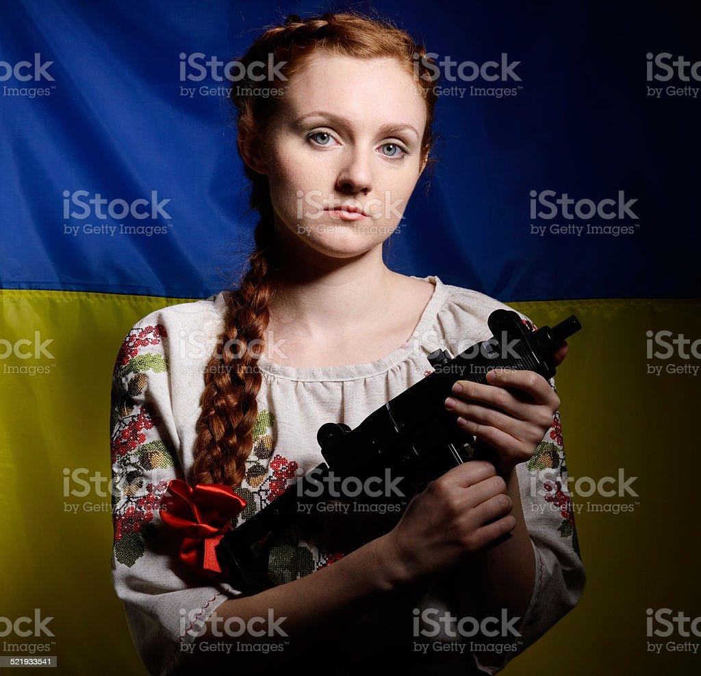 Ukrainian girl with a machine gun stock photo
