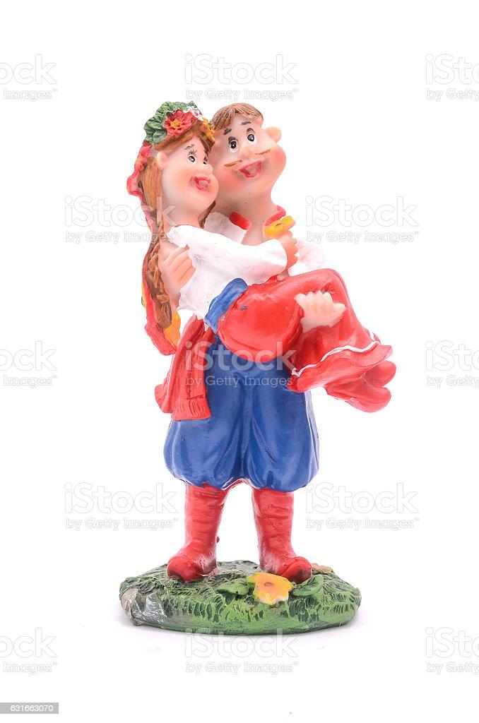 Ukrainian man and woman figurine isolated on white stock photo