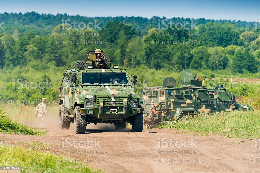 Ukrainian military vehicle KrAZ Spartan with comandos attack sim stock photo