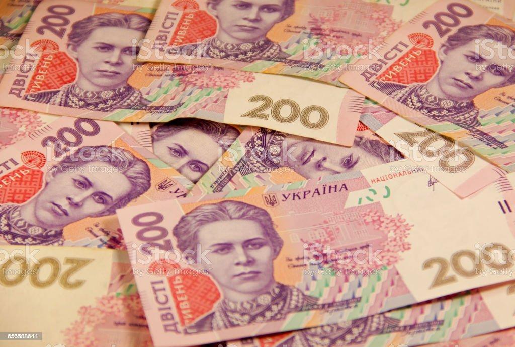 Ukrainian money. Background of the two hundred hryvnia banknotes stock photo