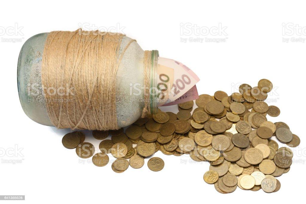 Ukrainian money in a glass jar stock photo