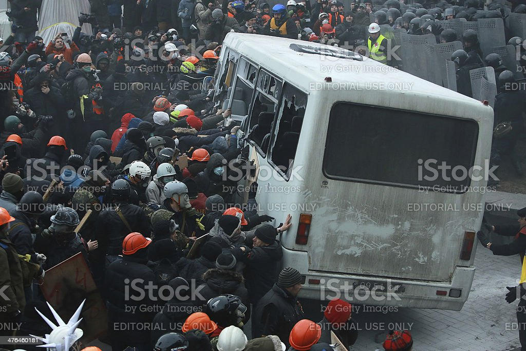 Ukrainian protesters break a police bus. royalty-free stock photo
