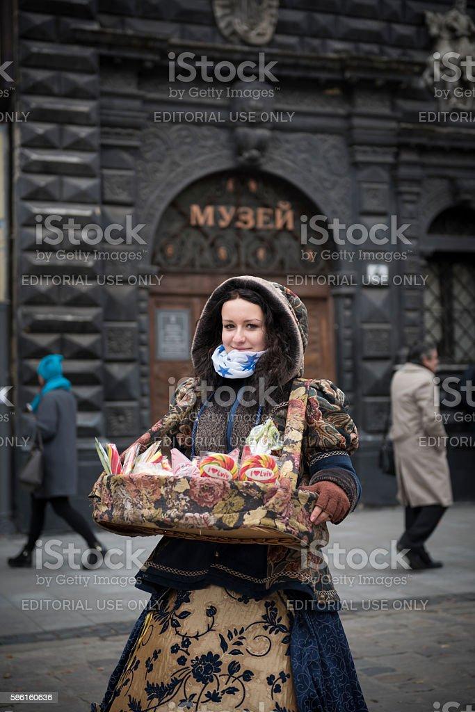 Ukrainian woman selling sweets in Lviv, Ukraine stock photo