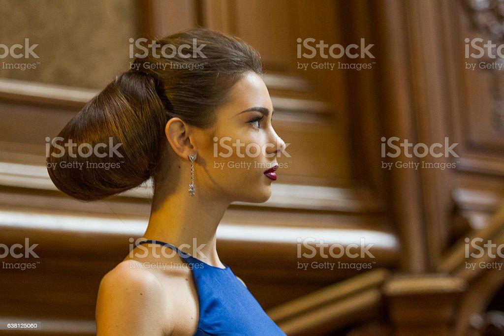 Ukranian female model posing at historical building in  lviv ukraine stock photo