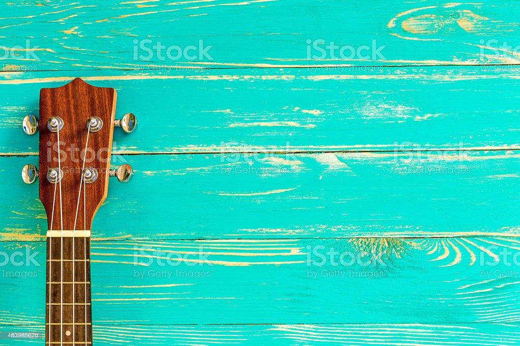 Ukulele Background / Ukulele / Ukulele on Blue Wooden Background stock photo