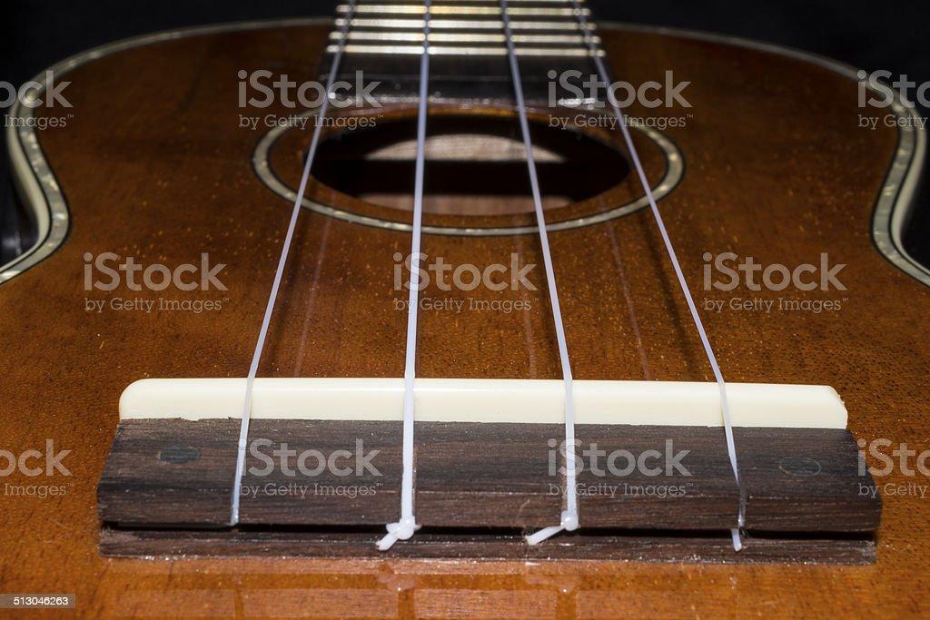 Ukulele Bridge and soundhole with strings royalty-free stock photo