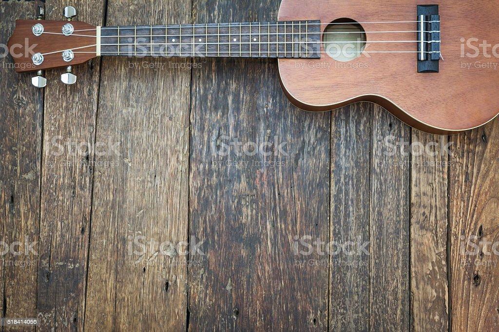 Ukulele on old wooden background, Dark tone stock photo