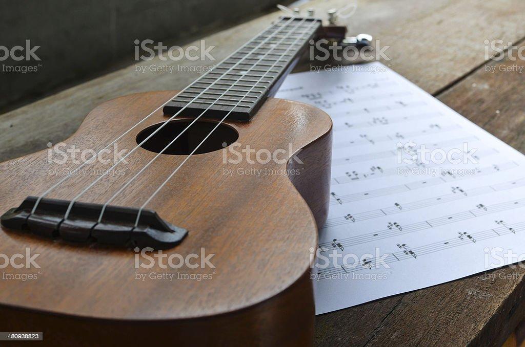 Ukulele with music notepad stock photo