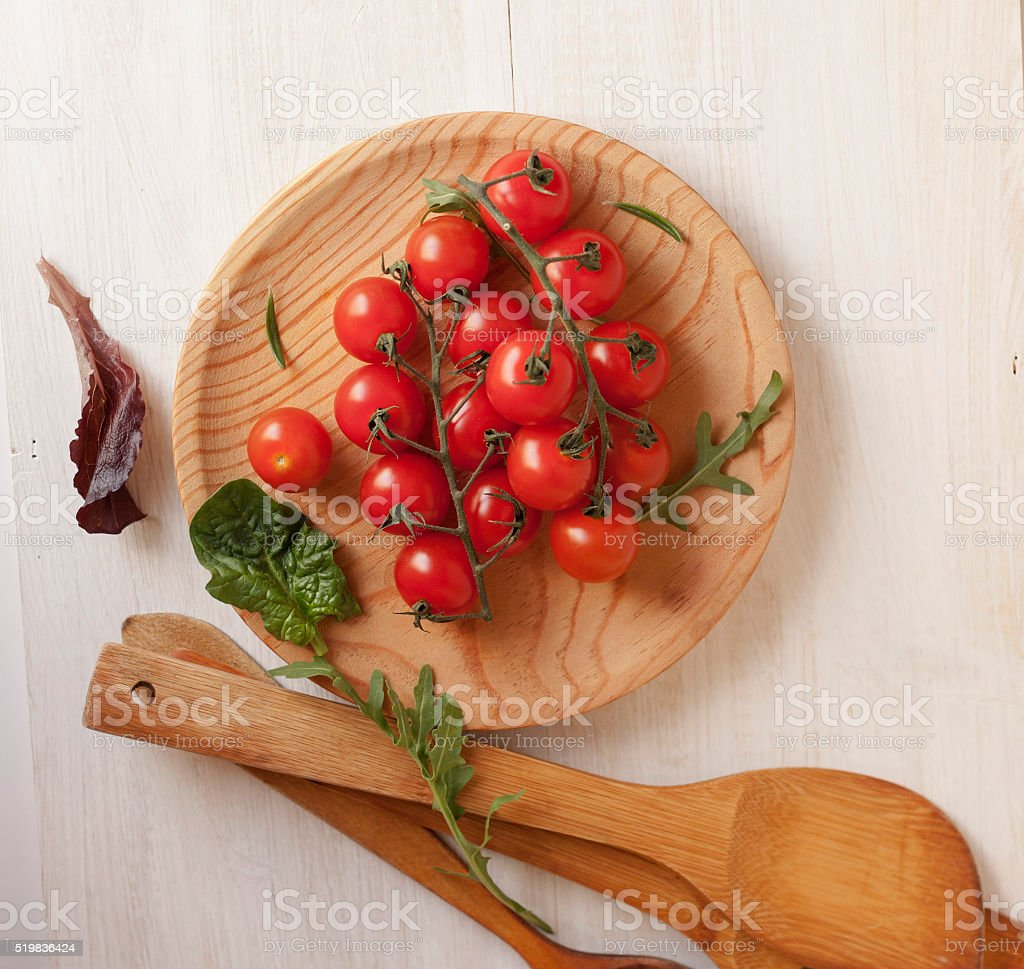 ull top view of a bunch of cherry tomatoes stock photo