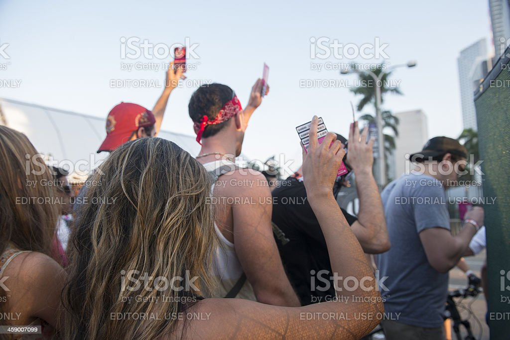 Ultra Attendees Line up with Tickets stock photo
