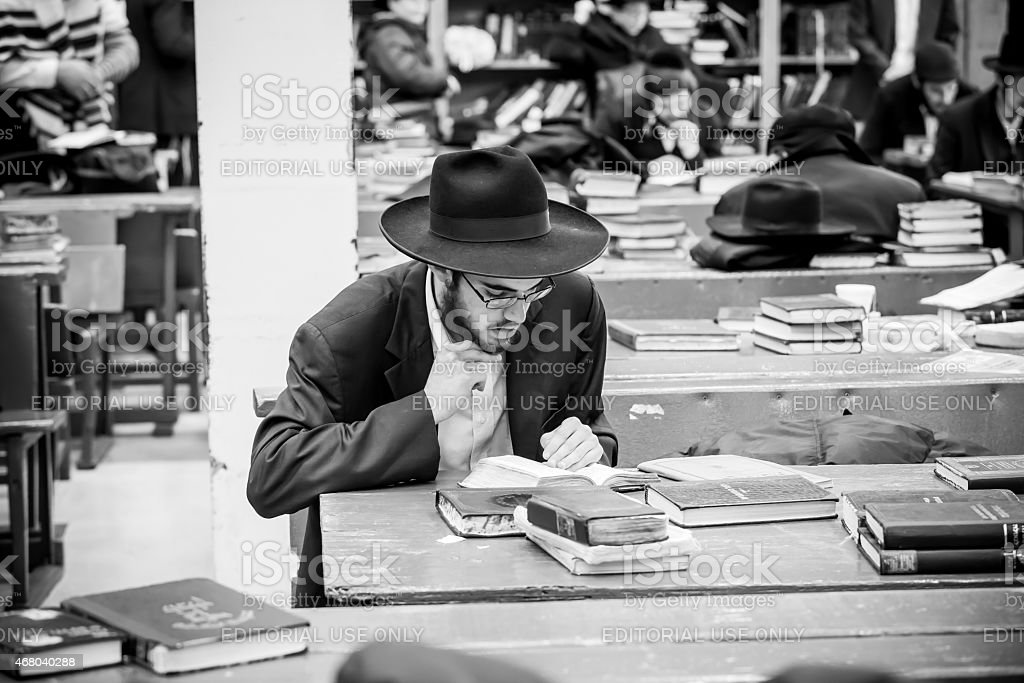 Ultra Orthodox Jewish man prays during service stock photo