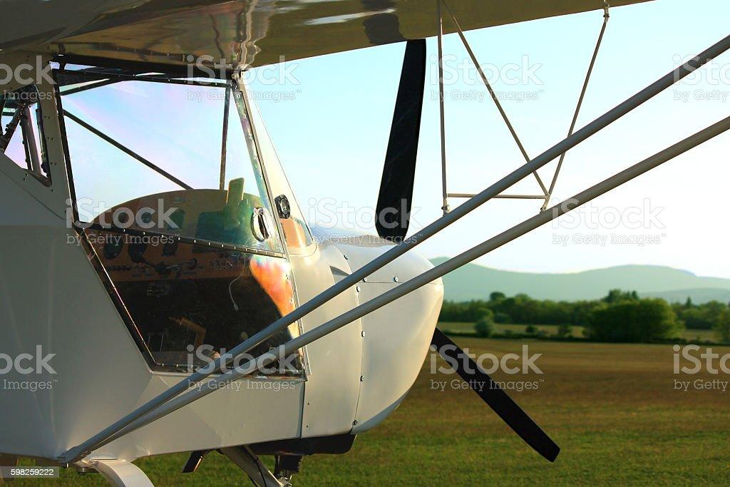 Ultralight aircraft in sunset stock photo