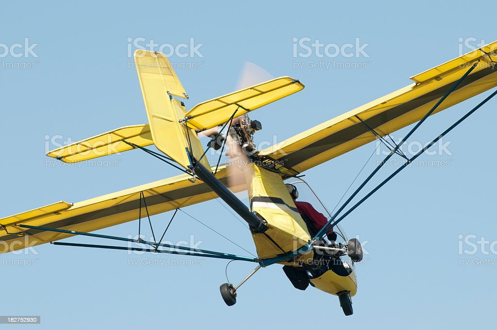ultralight airplane Quicksilver GT400s flying in blue sky royalty-free stock photo