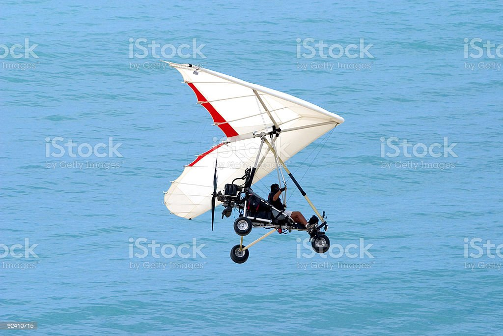 Ultralight Flying over the Ocean royalty-free stock photo