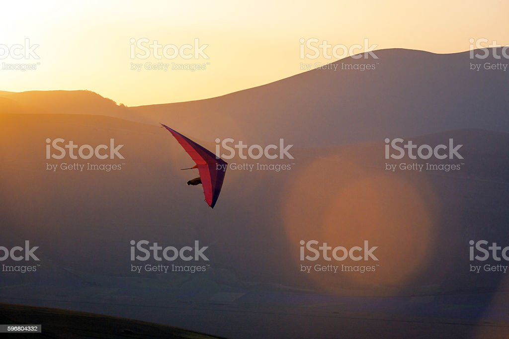 Ultralight -Hang Glider Pilot Launching,lens flare,Castelluccio,Apennines,Italy stock photo