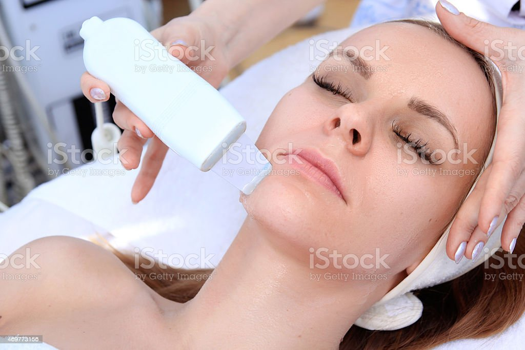 Ultrasonic cleaning person royalty-free stock photo