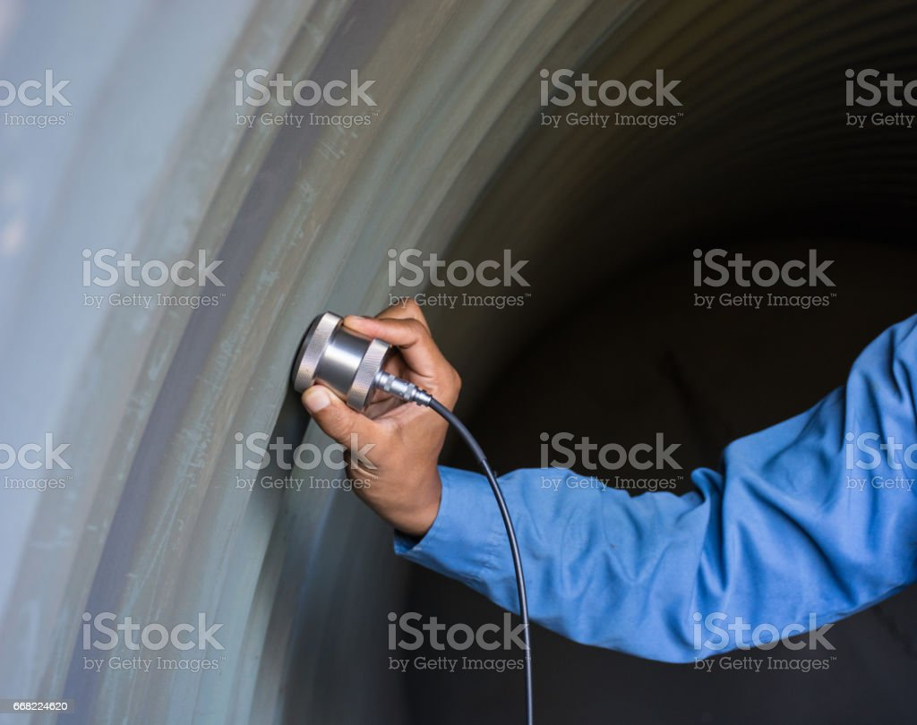Ultrasonic test to detect imperfection or defect of wall thickness steel plate in Workshop, NDT Inspection. stock photo