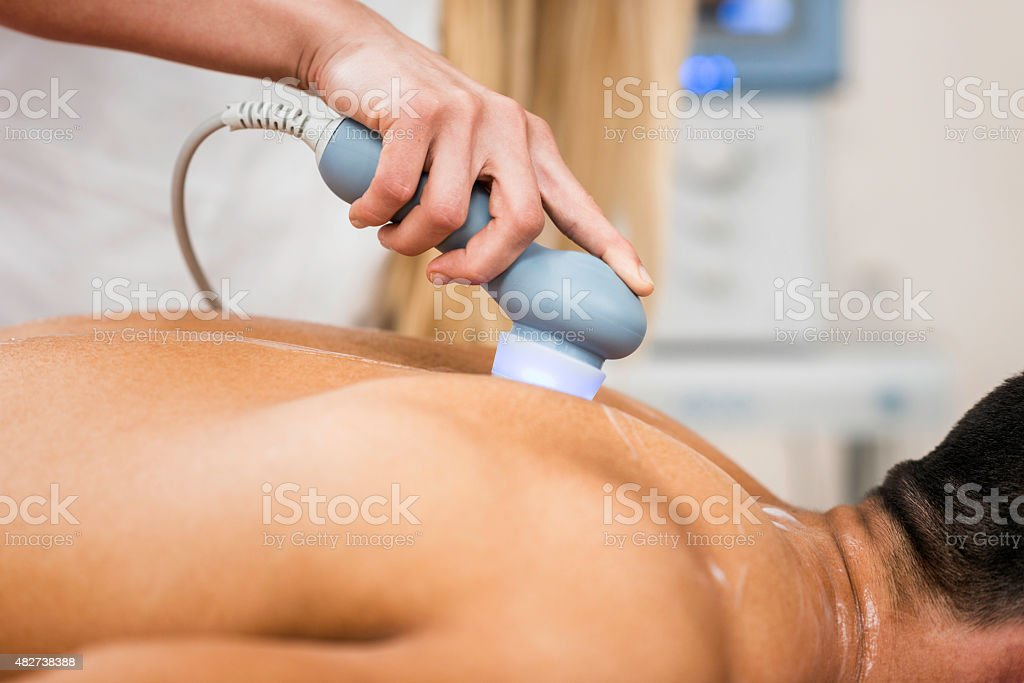 Ultrasound in physical therapy stock photo