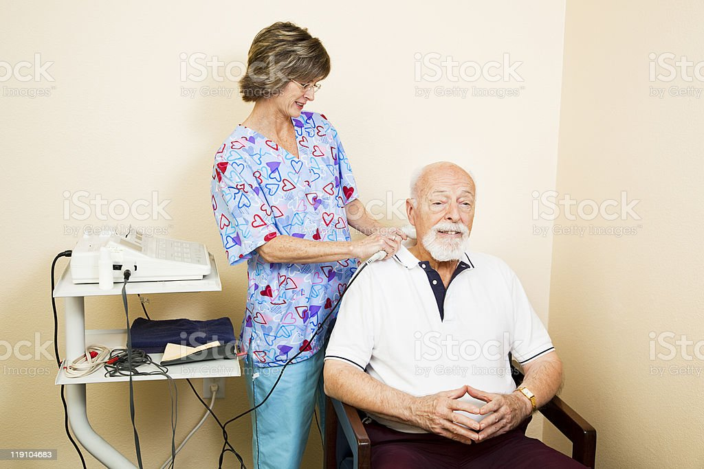 Ultrasound Therapy for Senior Man royalty-free stock photo