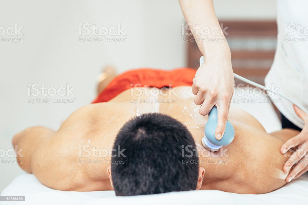 Ultrasound treatment in physical therapy stock photo