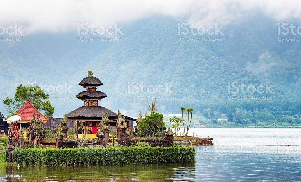 Ulun Danu temple in Central Bali panorama with lake stock photo