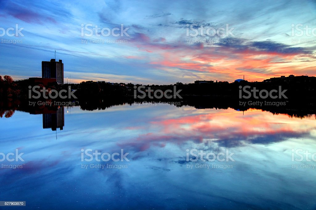 UMass Lowell reflecting on the Merrimack River stock photo