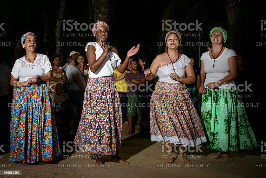 Umbanda women during jongo dance performance, Brazil stock photo