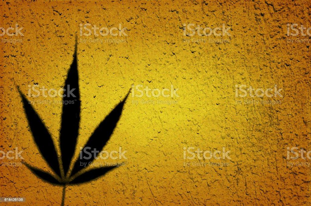 Umber background with marijuana leaf stock photo