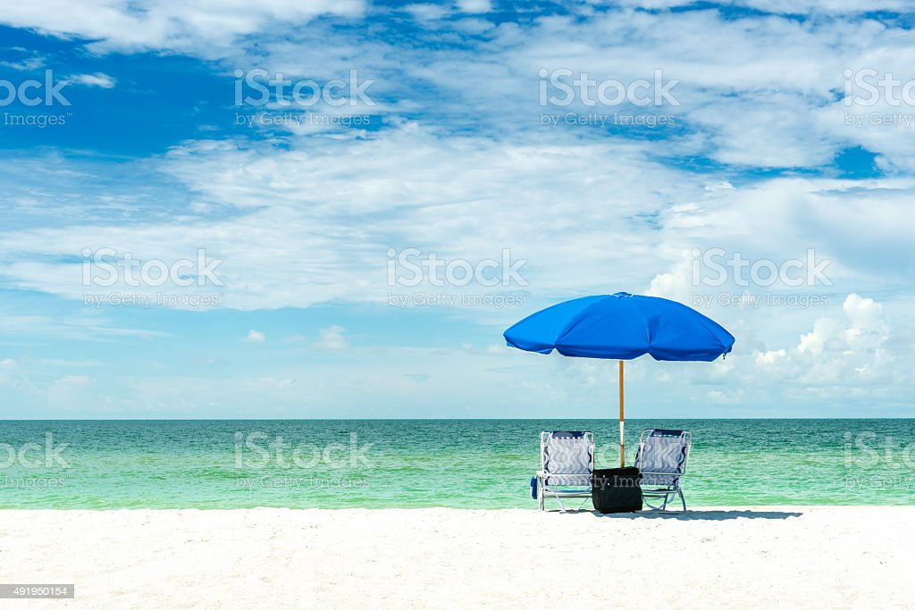 umbrella and chairs on a beach stock photo